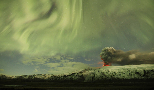 Reuters Best Photos of 2010 – LUCAS JACKSON captures the northern lights over the erupting Icelandic volcano
