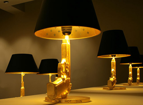 View in gallery phillipe starck bedside gun lamp 1 deadly design 20 dangerous weapon inspired designs