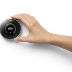 nest_thermostat_with_hand