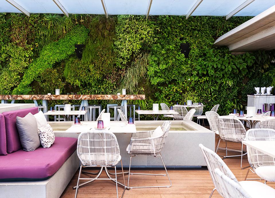 Juvia-Miami---Terrace-seating-and-green-wall