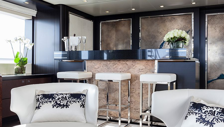 Macassar ebony paneling stainless teel frames shape the lavish interior of the luxury yacht