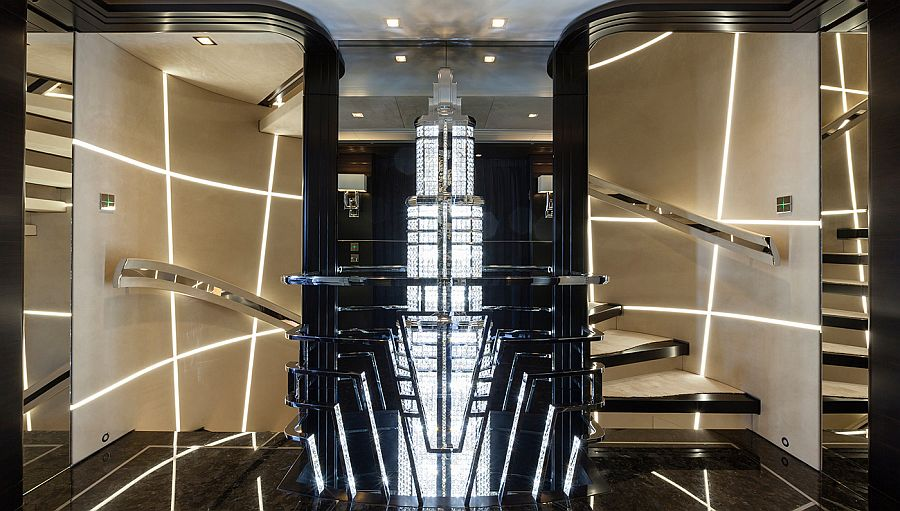 Twin staircases with an art-deco chandelier in between on the luxury yacht Ann G