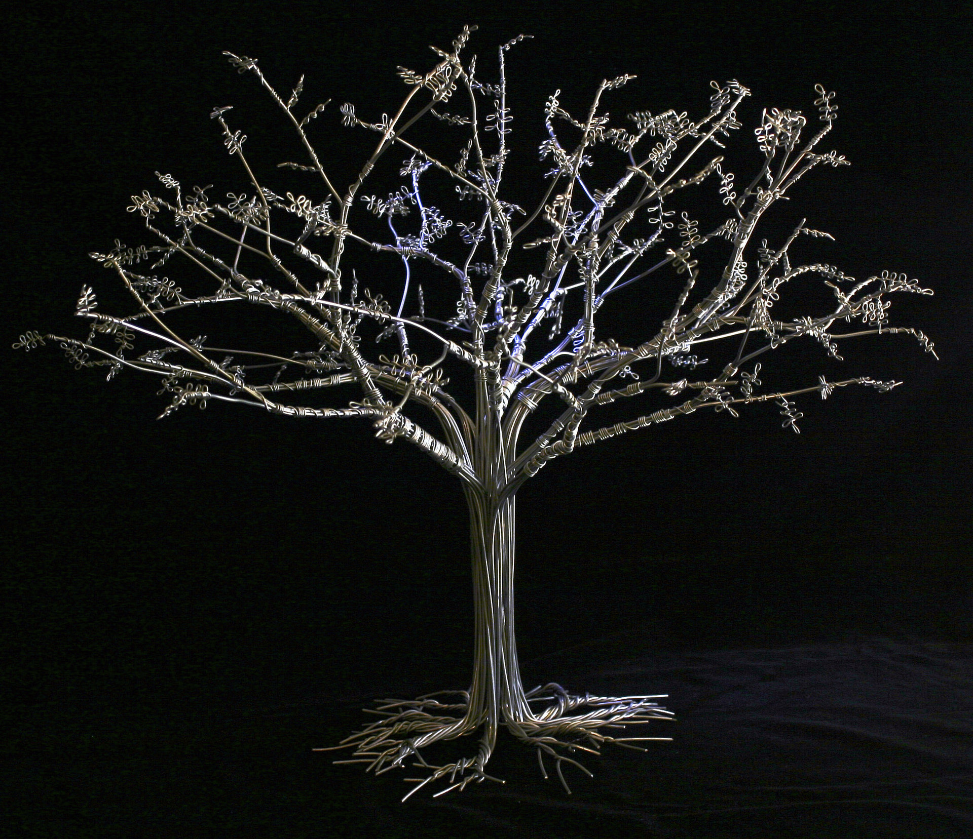 'Under the Tree' by Clyde Bango – wire sculpture