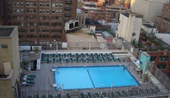 Holiday Inn Midtown rooftop pool nyc 345x200 Rooftop Pools in NYC to Defeat the Summer Heat