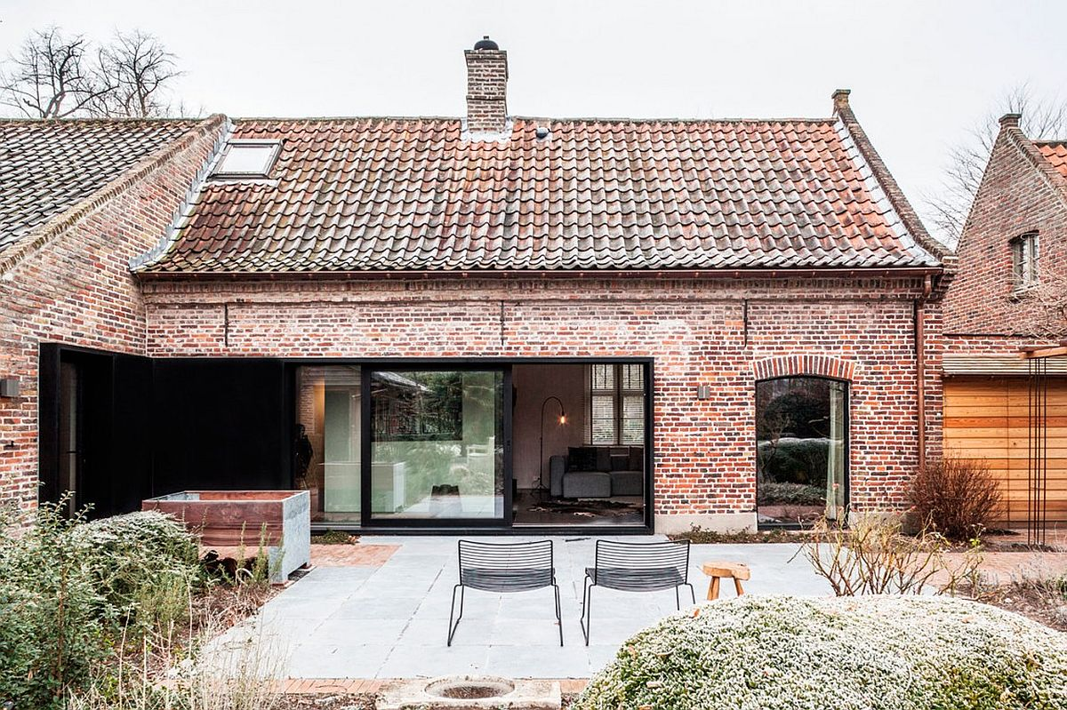 Farmhouse from outer patio Belgian Farmhouse Gets Gorgeous Interior Makeover but Preserves Rustic Aesthetic