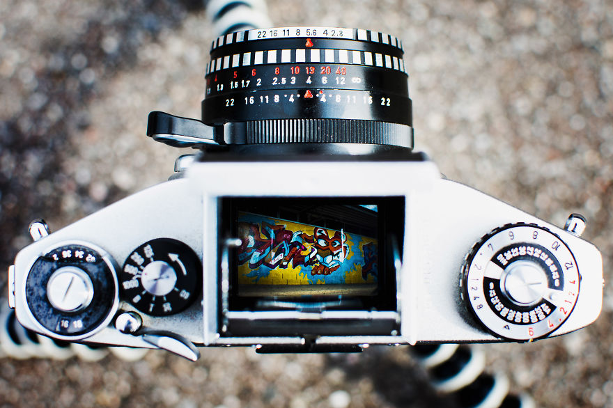 Graffiti wall through a vintage viewfinder