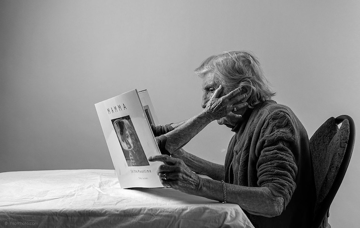 Mom caresses her own face from the pages of a book