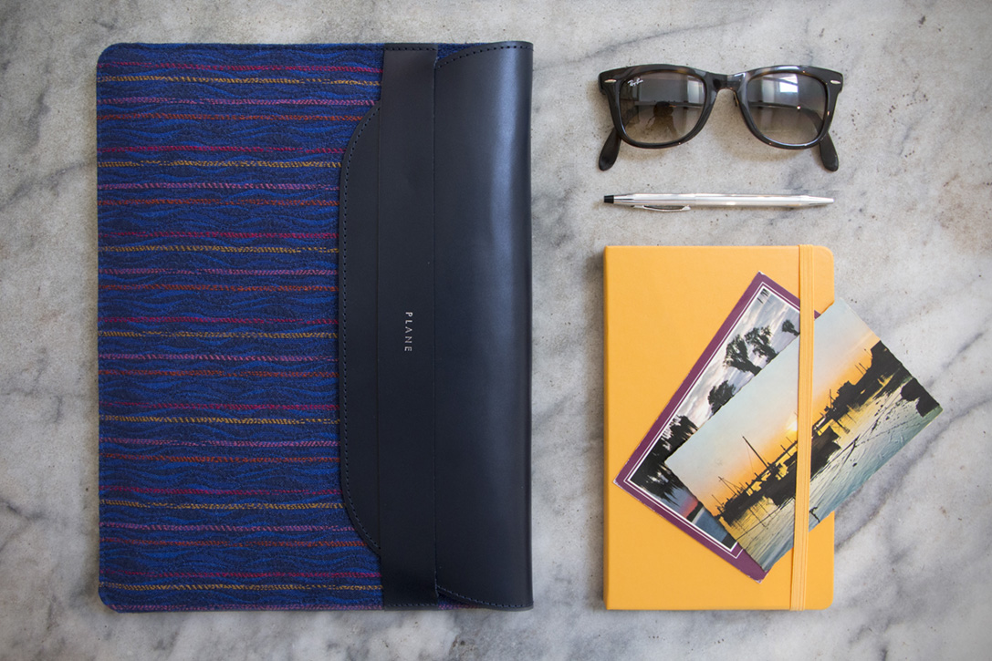 Patterned luxury laptop sleeve made from recycled airport carpet