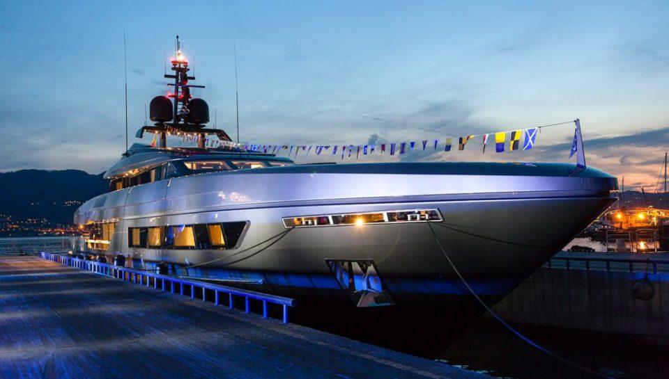 The yacht docked at dusk