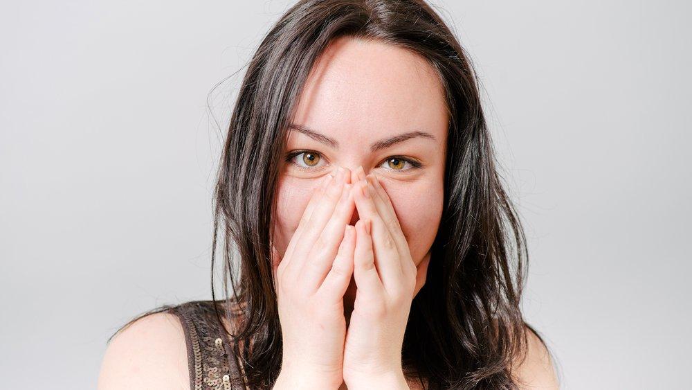 woman embarassed blushing