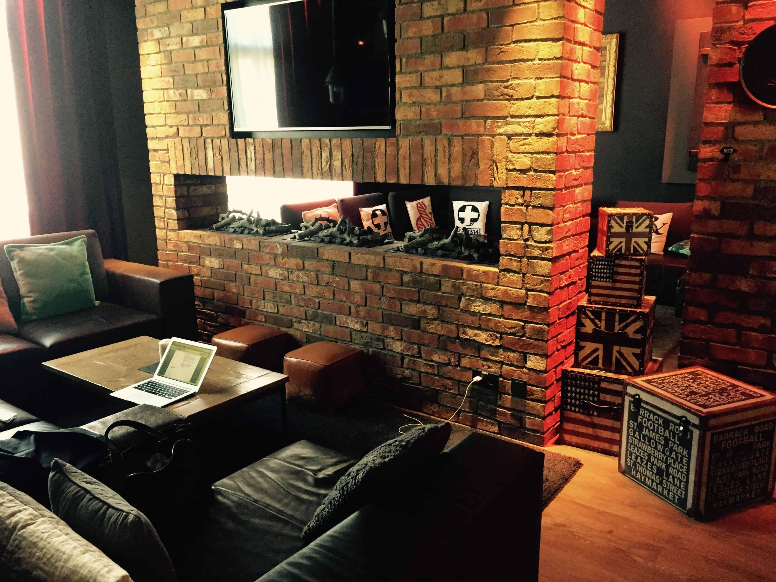 Brick wall and modern leather sofa – pentahotel paris
