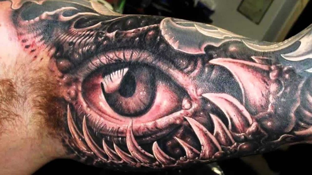 Mutated eye and jaw 3D tattoo