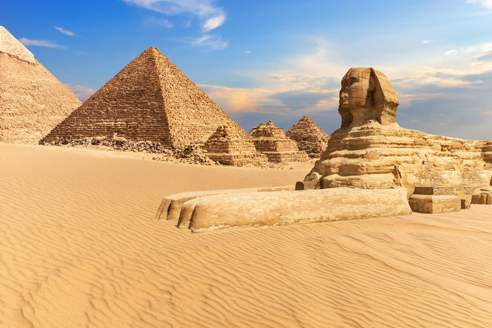 Sphinx of Giza next to the Pyramids