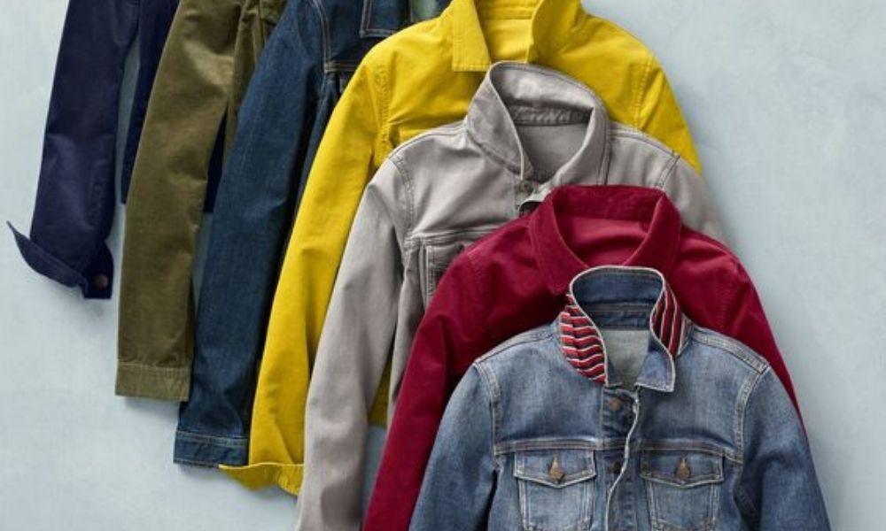 A variety of colored denim jackets: black, olive, blue, mustard, grey, red, and washed indigo