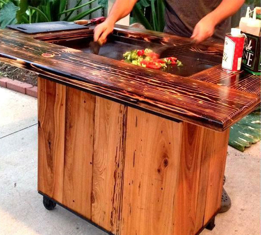 The gorgeous Backyard Hibachi Flattop Propane Gas Grill with Torched Cypress Surface