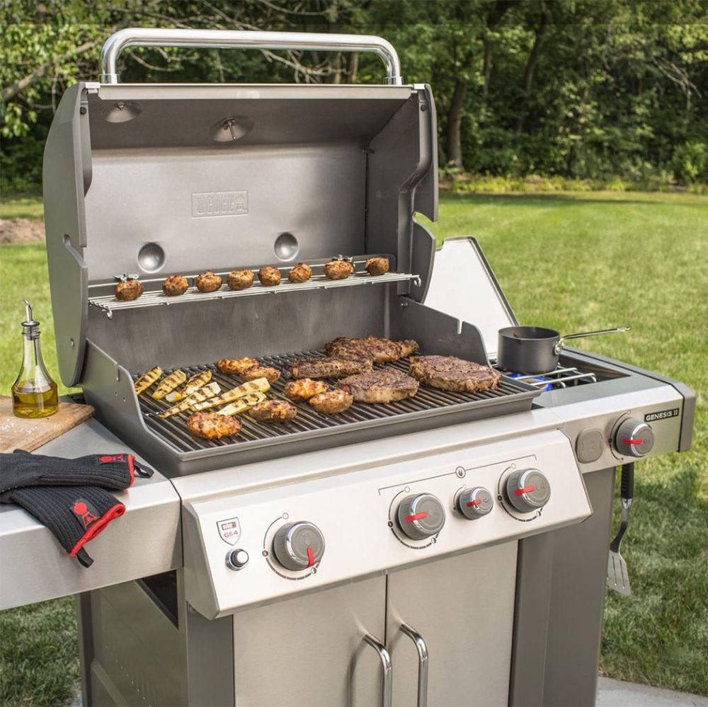 Burgers, chicken, and potatoes grilling on the Weber Genesis II S 335