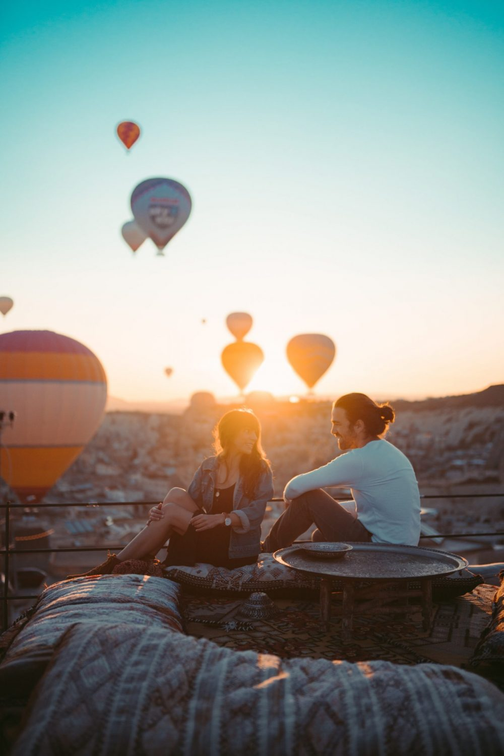 Good Pick Up Lines - Laughing Couple and Hot Air Balloons